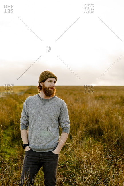 Bearded man in the english countryside at sunset