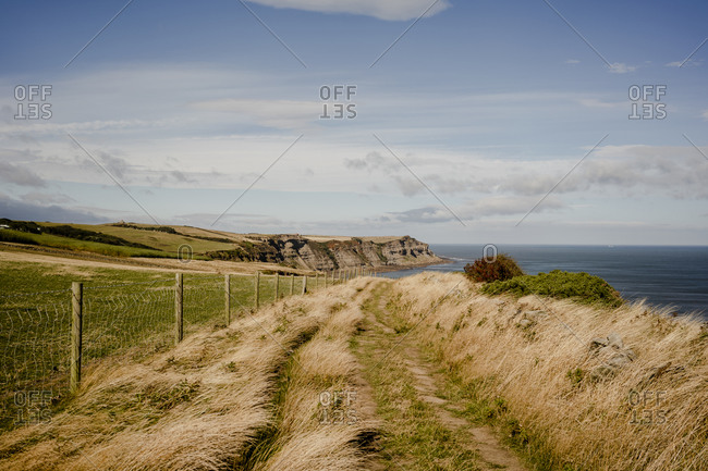 Walking path between whitby and robinshood bay with ocean in the