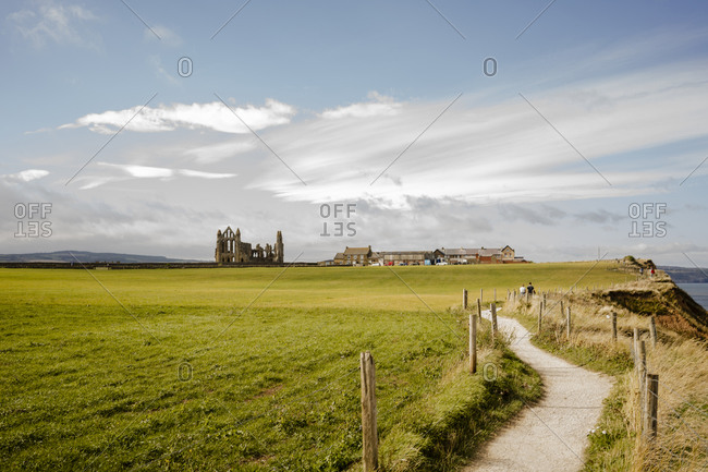 Walking path between whitby and robinshood bay with whitby abbey