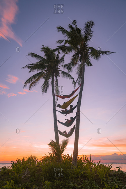 Philippines - may 9, 2018: hammock life between two coconut trees during sunset