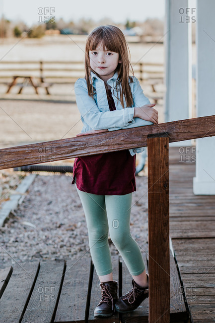 Vertical portrait of young girl outside on a sunny day