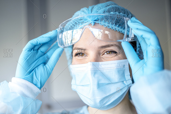 Happy medical surgical doctor and health care, portrait of surgeon doctor in ppe equipment on isolated background. medicine female doctors wearing face mask and cap for patients surgery work.