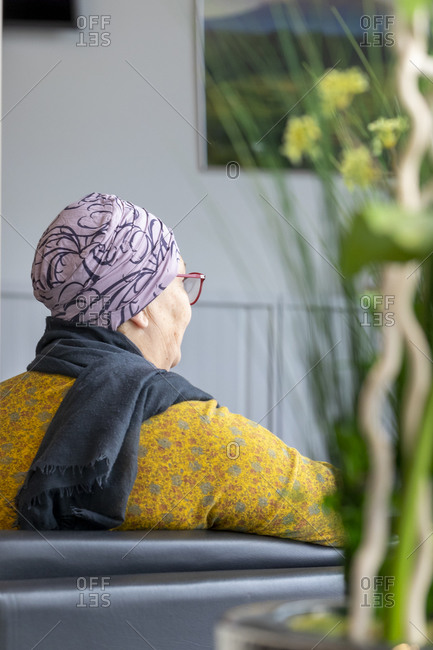 An oncology patient waits in the waiting room