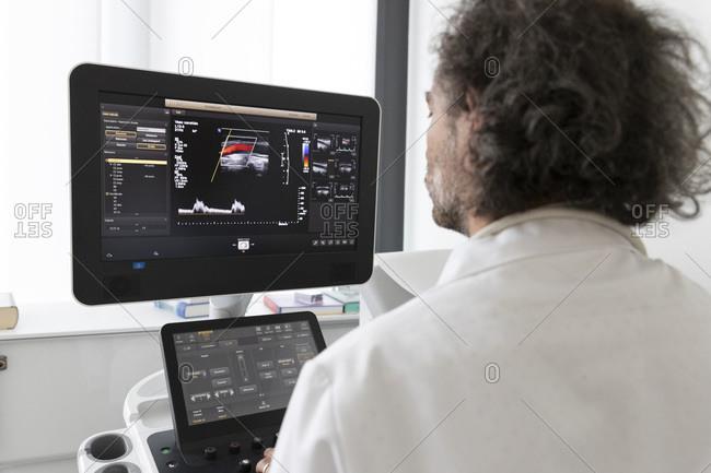 A neurologist gives an ultrasound to a patient
