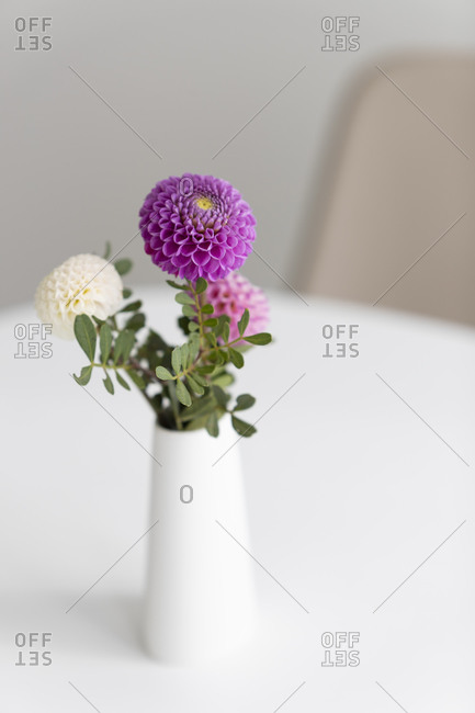 Flowers in a vase, placed on a white table