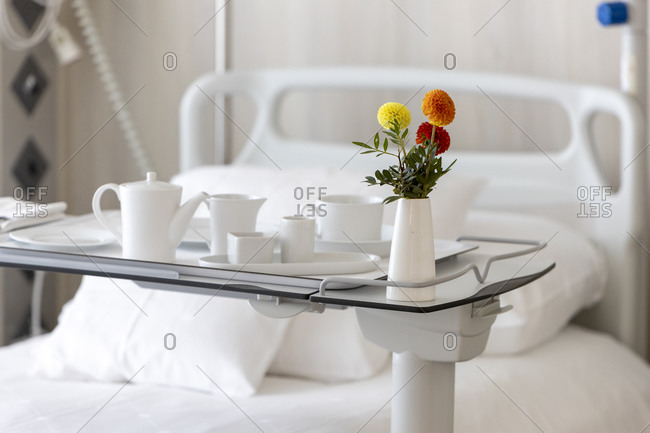A hospital bedside table, with a meal tray