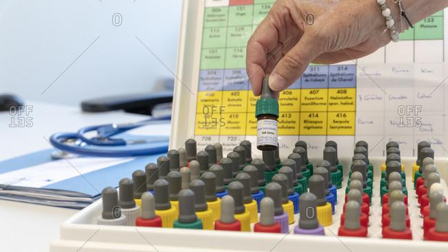 An allergist prepares a skin test