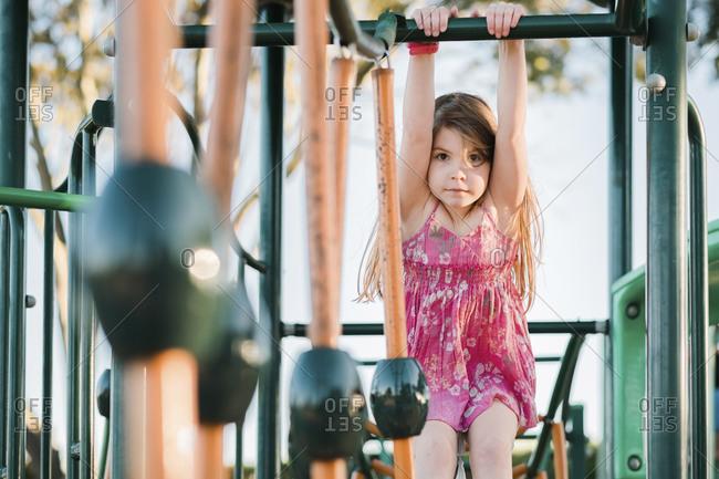 Girl swinging on equipment at the playground
