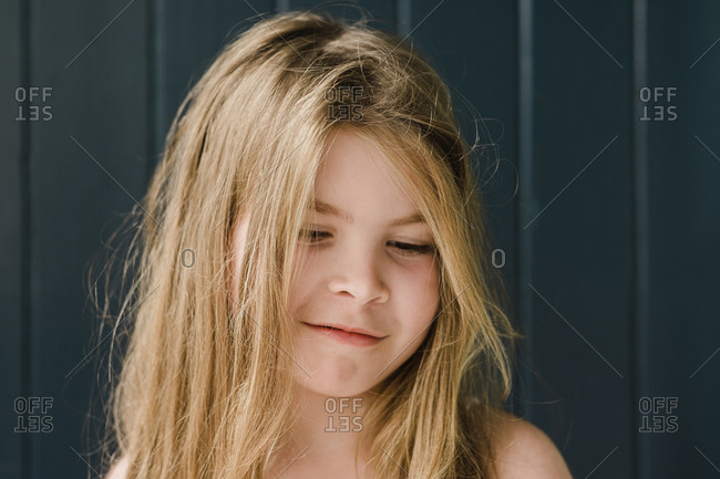 Closeup of a smiling young girl in front of a door outside