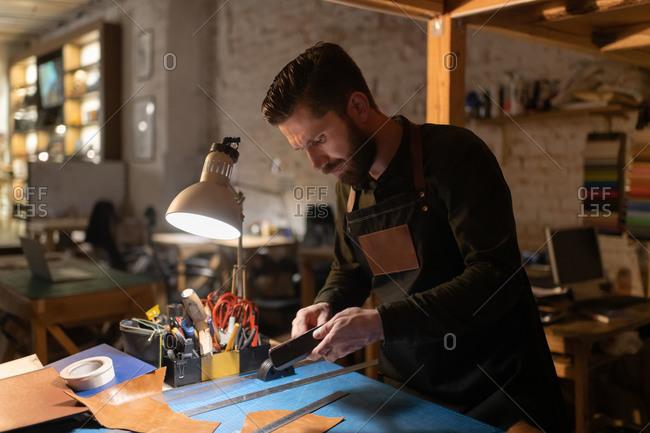 Craftsman preparing tools over workbench