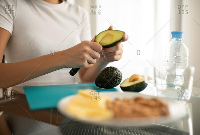 Female cooking healthy food being on keto diet