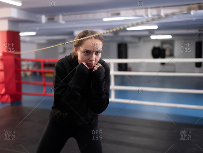 Female boxer in full crouch stance