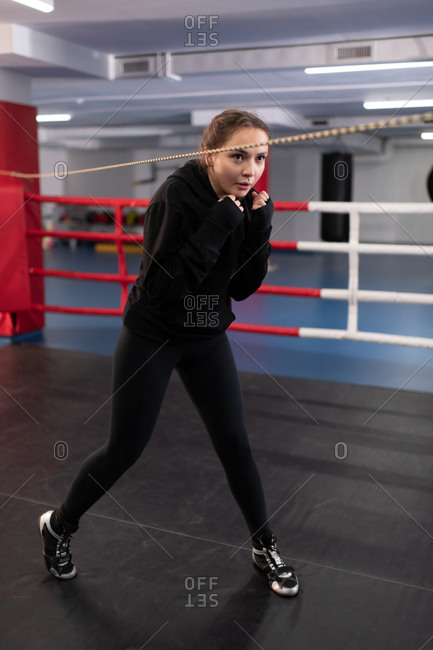 Female boxer practicing evasion movement