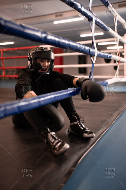 Angry female fighter resting after match