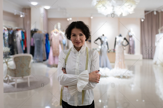 Successful female owner of fashion boutique looking at camera