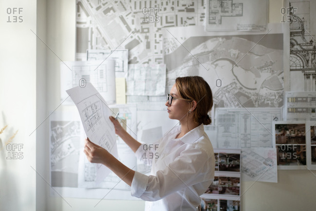 Smart architect examining draft during work