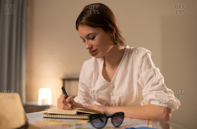 Young woman planning trip at home