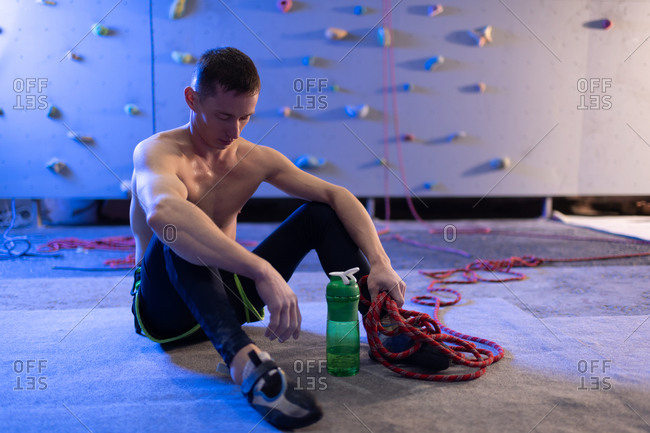 Tired athlete resting after climbing wall