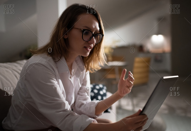 Professional businesswoman with tablet working at home