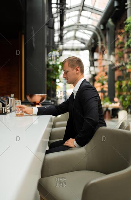 Entrepreneur sitting in luxury bar