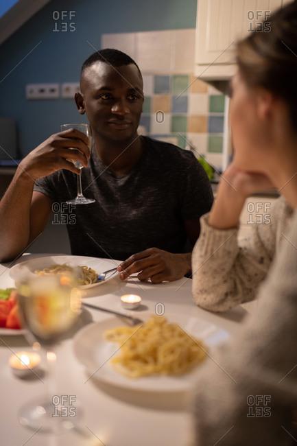 Black guy listening to girlfriend during date