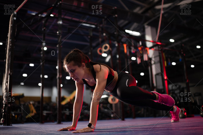 Strong woman exercising in modern gym