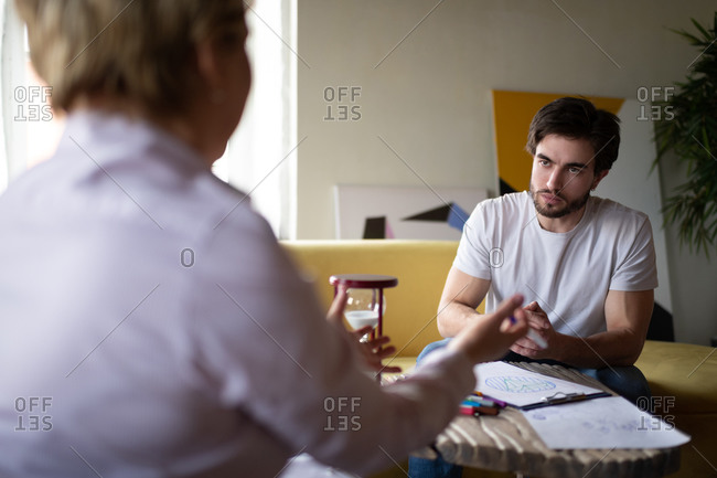 Counselor explaining psychotherapy test results to serious client