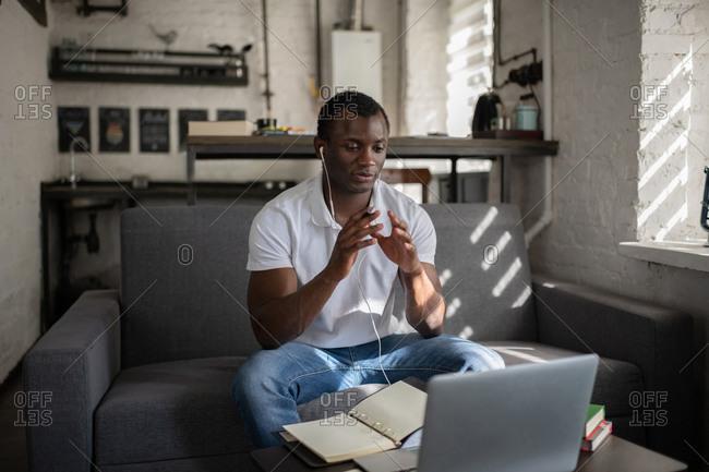 Black student talking with teacher online
