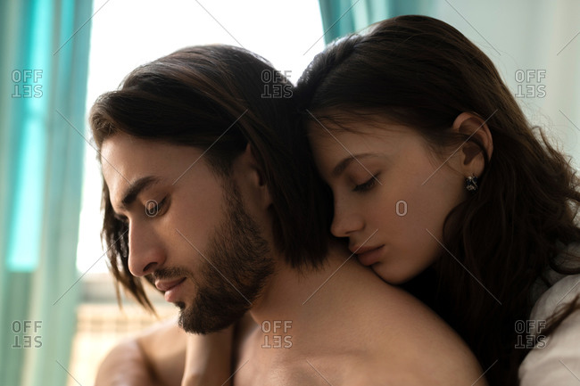 The portrait of the embracing  couple in the bedroom