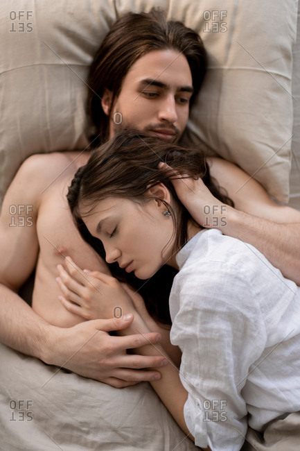 Portrait of a sleeping couple together in their home.