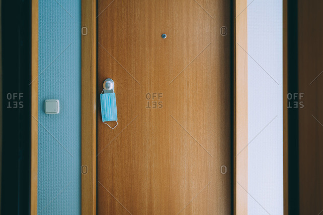 Door with mask hanged from the knob