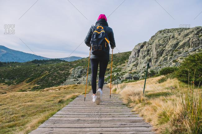 Trekking mountain poles landscape  adventure