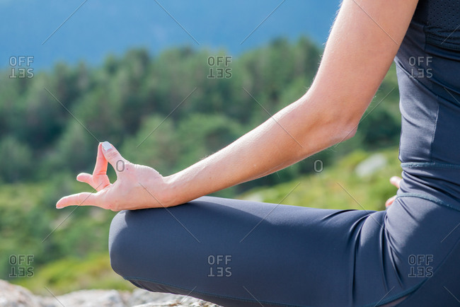 Woman meditating yoga mountain postures