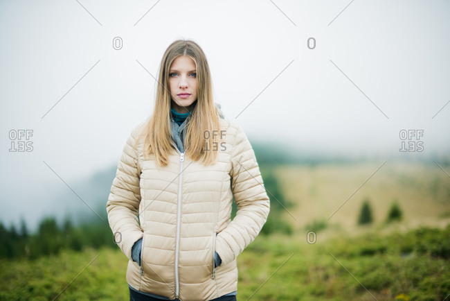 Blonde girl portrait near the forest