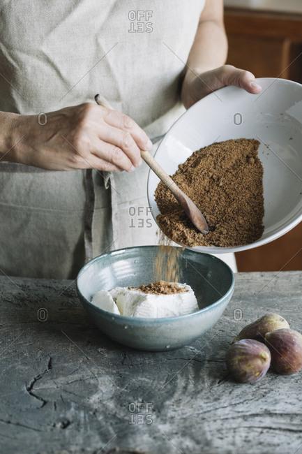 Woman making homemade cheese tart