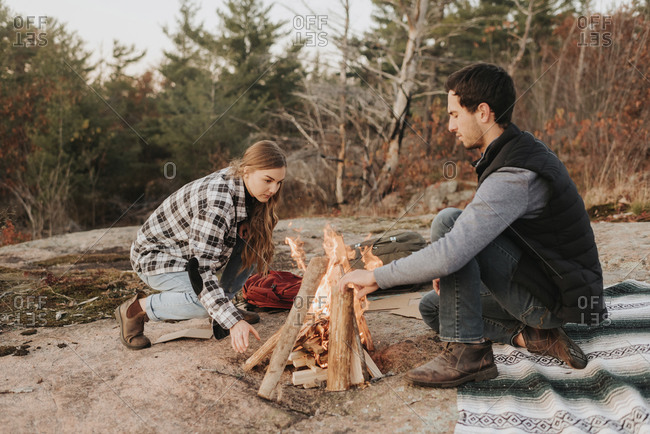Young couple preparing a campfire