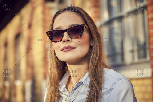 Businesswoman with sunglasses standing outdoors