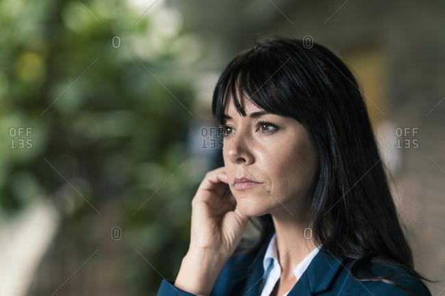 Elegant female entrepreneur looking away