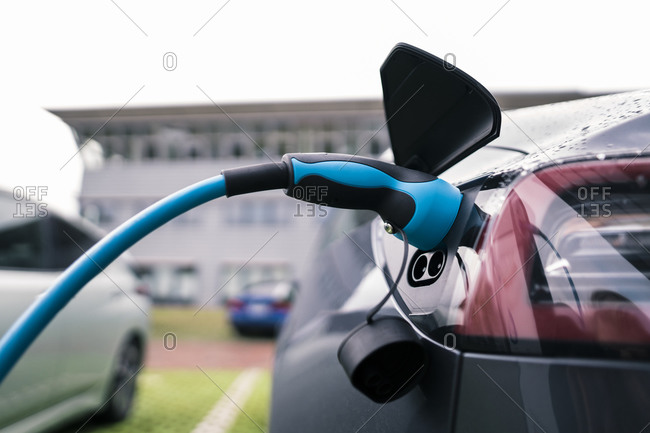 Electric car charging at station