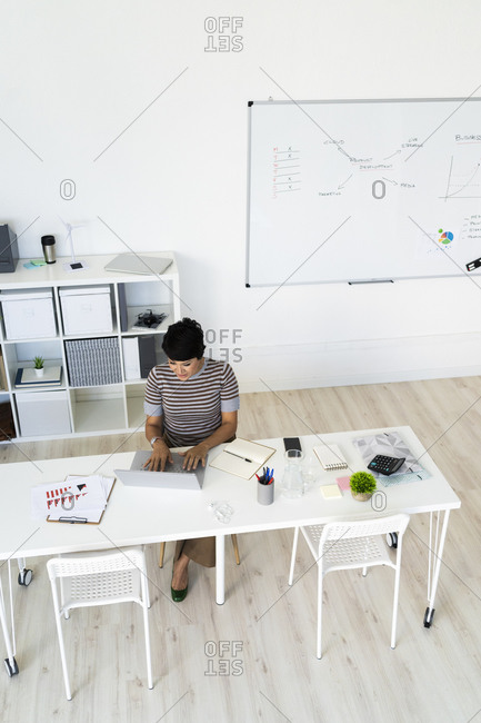 Businesswoman working alone at office table