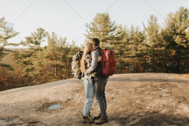 Young couple embracing during autumn hike