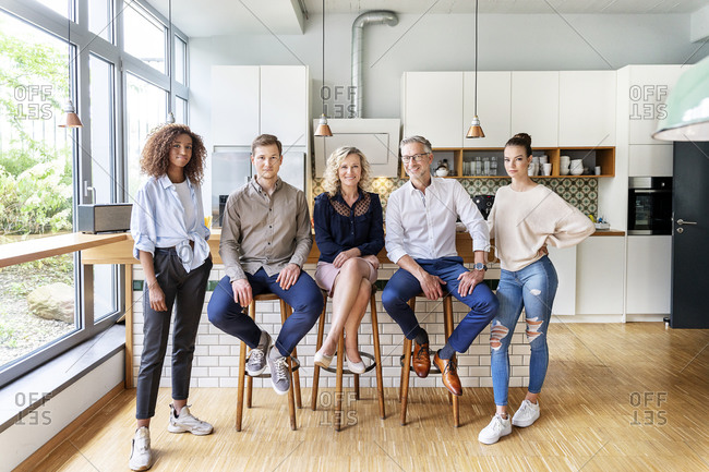 Confident multiethnic business people in office kitchen