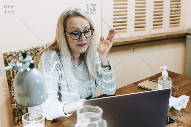 Senior woman taking online consultation at home