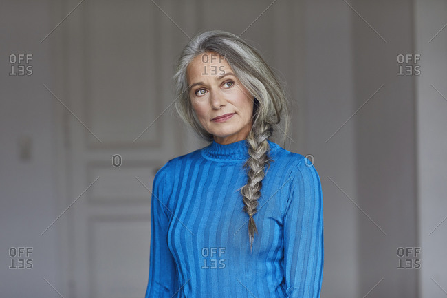 Thoughtful mature woman looking away at home