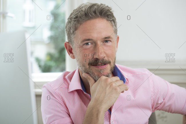 Mature male entrepreneur with hand on chin