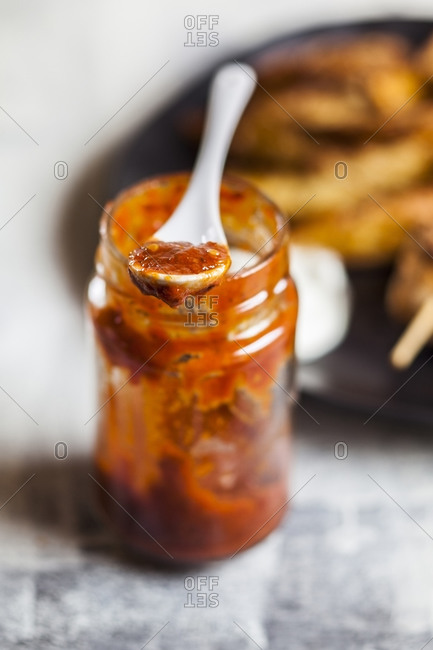 Homemade red chili sauce jar on table