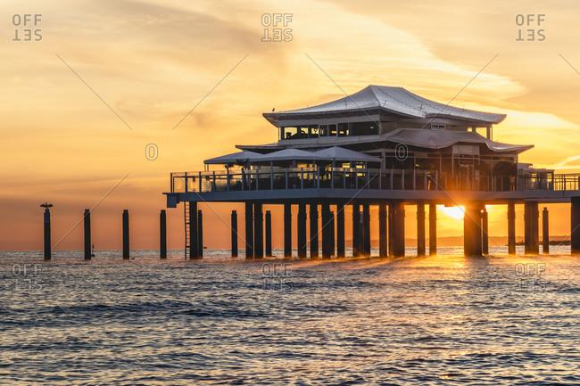 Germany- Schleswig-Holstein- Timmendorfer Strand- Coastal teahouse at sunrise