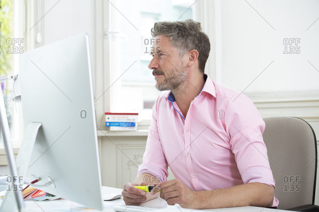 Businessman concentrating while working on computer at office
