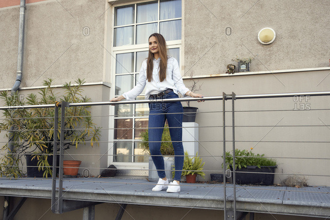 Businesswoman standing looking away while standing in balcony