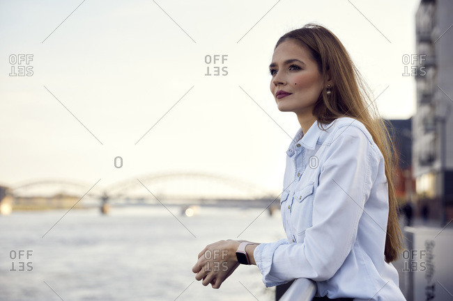 Thoughtful entrepreneur looking at view while leaning on railing